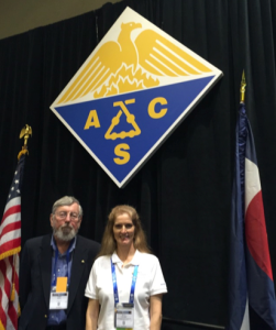 Dena Chubbic and John Berg with ACS symbol and American flag