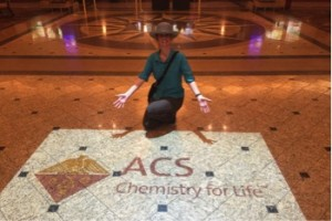 Dena with the ACS logo