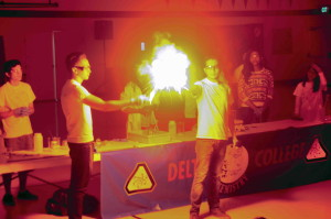 two chemists with a fireball between them