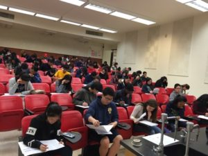 students sit in classroom and take test