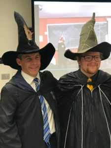 Two men in wizards' robes and hats